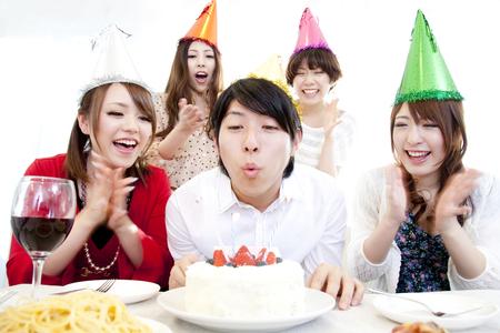 誕生日パーティーのための男女 写真素材
