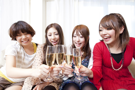 rollick: Women toasting with champagne