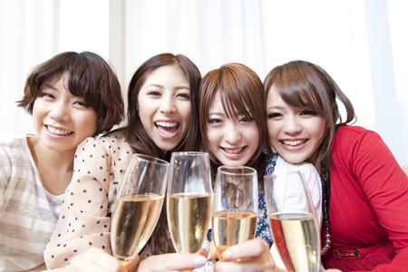 シャンパンで乾杯の女性 写真素材