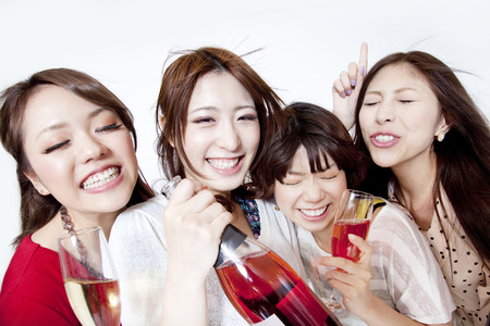 rollick: Women who dance with a champagne Stock Photo