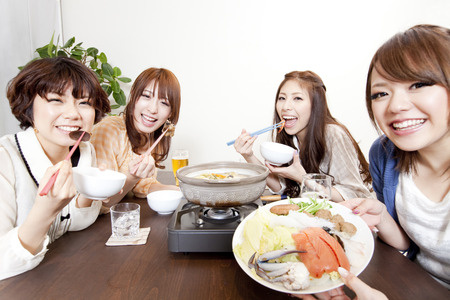 Women who eat hot pot Standard-Bild