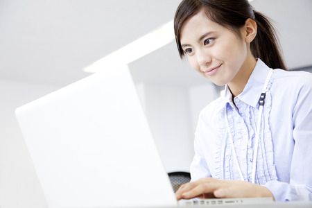 Women working with PC 版權商用圖片