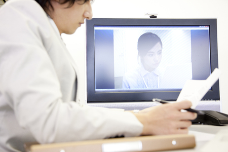 teleconference: Businessman to a meeting in TV phone