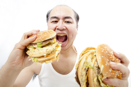 Middle-aged eat a hamburger man