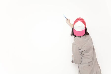 writing instrument: Women draw a picture on the wall