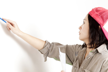 human being: Women draw a picture on the wall