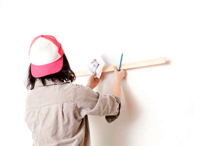 lad: Women draw a picture on the wall