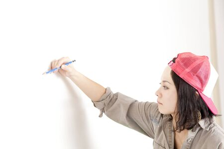 asian woman: Women draw a picture on the wall