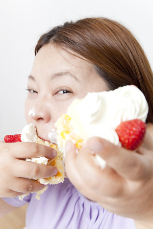 overweight women: Overweight women dig in to cake