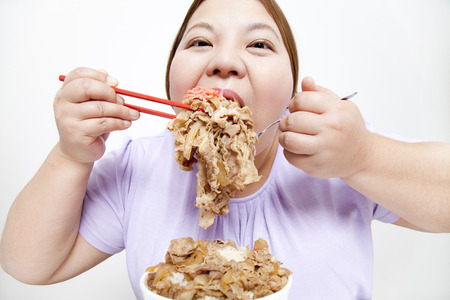 Overweight women eat beef Bowl