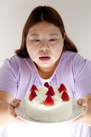 tempted: Overweight women tempted to cake
