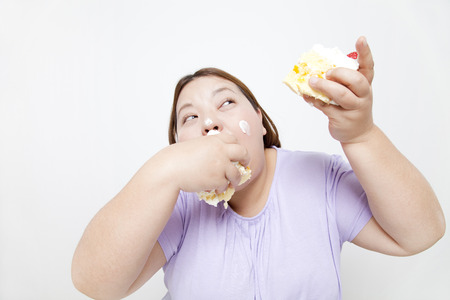 Overweight women dig in to cake