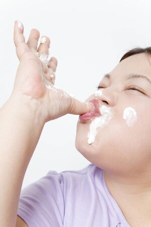finger licking: Metabo woman licking a final cream on finger Stock Photo