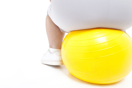 balance ball: Metabo woman sitting on balance ball Stock Photo