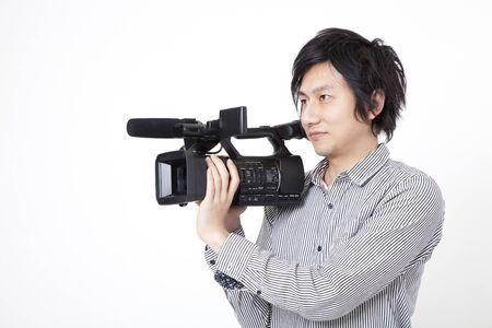 camara de cine: Gire el hombre de la c�mara de cine Foto de archivo
