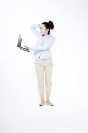 levitate: OL operating the notebook PC Stock Photo