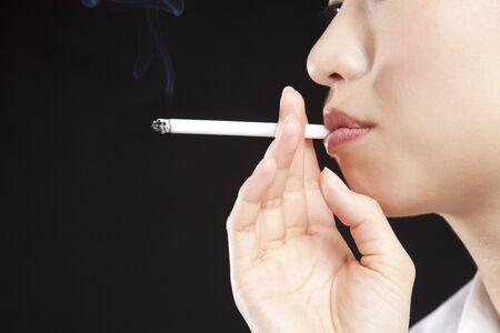 women smoking: Women smoking cigarettes