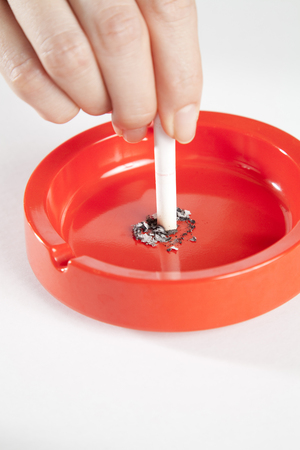 Hand extinguish a cigarette Stock Photo