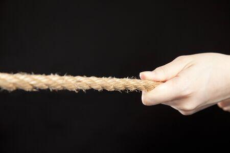 grab: Hands grab the rope Stock Photo
