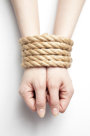arrest women: Hand to be bound by rope