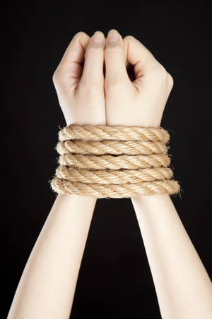 Hand to be bound by rope