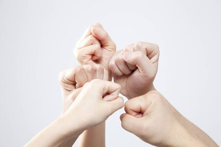 fist pump: Men and women of the hand to the guts pose