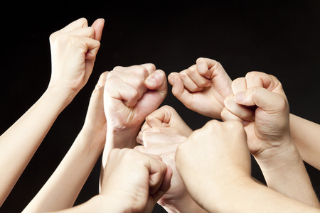 guts: Men and women of the hand to guts pose Stock Photo