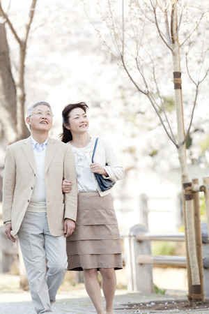 pleasant emotions: Senior Couples Arms Crossed