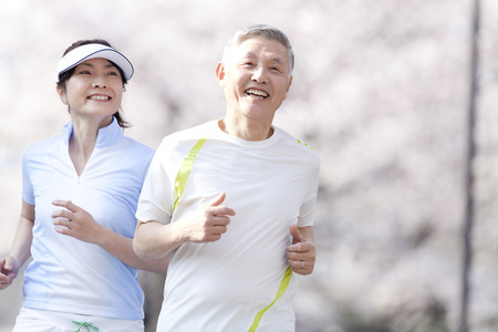 asian trees: Senior couple jogging