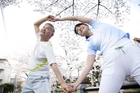 Senior couple to stretch Stock Photo
