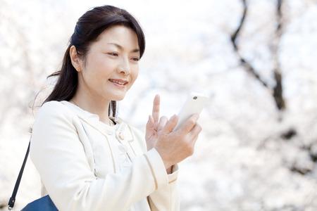 Senior women working with smart phones