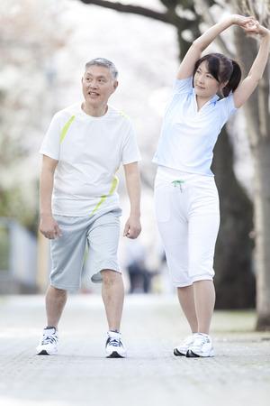 pliable: Senior couple to stretch Stock Photo