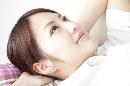 loosen up: Women lie down on the sofa