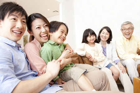 大家族をテレビします。 写真素材