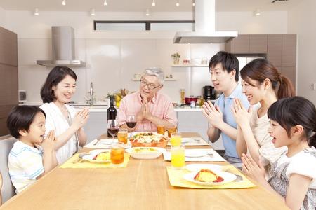 three generation: Surrounding the table three generation family Stock Photo