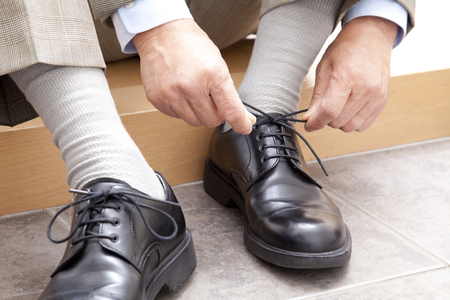 early fifties: Men tie the shoelaces Stock Photo