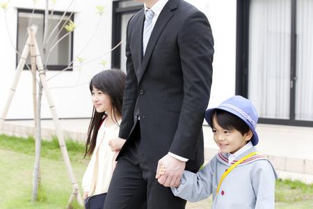 kindy: Parentchild connecting hands Stock Photo