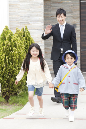 kindy: Children to school with dad Stock Photo