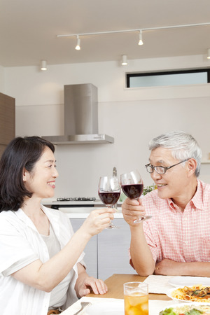 eating dinner: Couple to toast with red wine