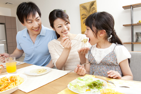 couple dining: Parent-child meal Stock Photo