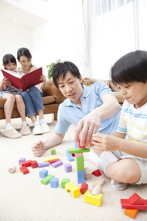 living being: Parent and child to relax in the living room Stock Photo