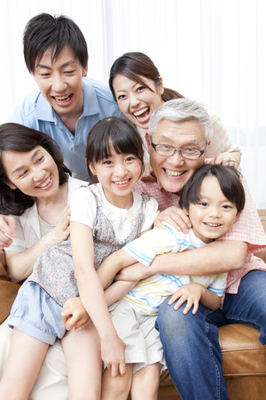 family in living room: Of large families smile
