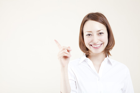 Woman pointing to Stock Photo