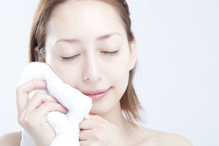 Women wipe the face with a towel Stock Photo