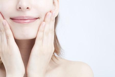 beautiful skin: Woman hand to ones cheeks Stock Photo