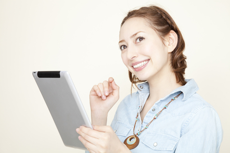 Women working with Tablet PC photo