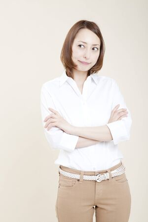 fold ones arms: Woman to his arms folded Stock Photo