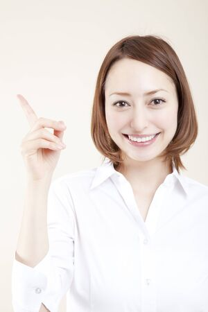to be pleasant: Woman pointing to Stock Photo