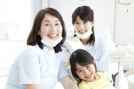hygienist: Dentist and dental hygienist and the patients girl