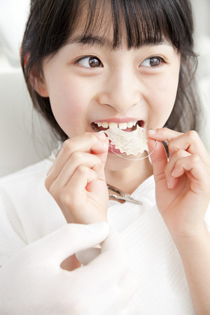 orthodontic: Girl to put the orthodontic appliance of the teeth